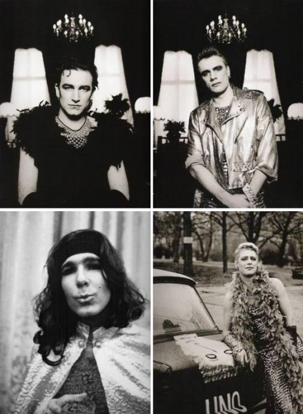 The members of the band U2, all of whom are in drag -- complete makeup, jewelry, and dress.