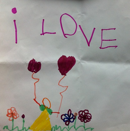 "A child's drawing saying ""i love"" above a person holding two heart-shaped balloons; the person is standing between a couple of flowers."